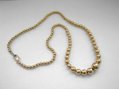 Vintage gold tone metal ball necklace by badgestuff on Etsy, $6.00