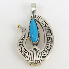 """Heavy Sterling Silver Pendant with Hopi Overlay Designs and set with Natural Morenci Turquoise from Arizona. This pendant also features 14k Gold applique dots. 1.25"""" Width, 2.375"""" Height"""
