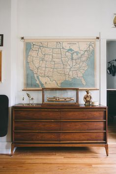 WELCOME TO HOMESTEAD 05 | Lane Mid Century lowboy dresser, vintage model boat, US highway pull-down map.