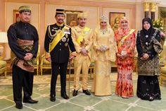 Brunei's newly wed royal couple, Prince Abdul Malik and Dayangku Raabi'atul 'Adawiyyah Pengiran Haji Bolkiah, pose with members of Brunei's royal family, for photographers after the enthronement cerem