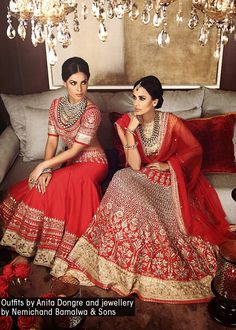 Anita Dongre. I actually prefer the one that is further back for the ceremony-- high neck blouse, gota pati on the lengha.
