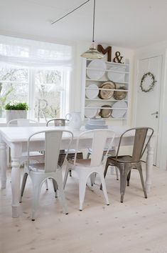 source: Biskopsgården ~ comfy and fun cottage dining room