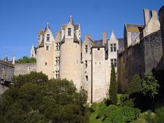 Montreuil Bellay Castle - This vast Medieval structure hasan authentic Medieval kitchen, beautiful frescoes, and vaults.