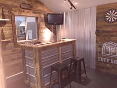 You can't have a pub shed without a wet bar! A flatscreen, dart board, and reclaimed wood make this pub shed the ideal backyard addition.