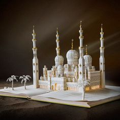 Altered book sculpture of the Sheikh Zayed Grande Mosque in intricate detail by Su Blackwell