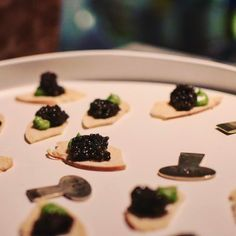 Avocado mousse and ROE Caviar on homemade bagel crisps by Bouchon.