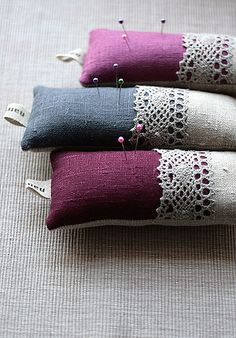 Use some scraps of old linens combined with intense coloured linens to make pin cushions