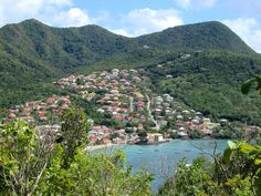 Houses climb the hillside behind Petite Anse d' Arlet on Martinique, Eastern Caribbean. Climbing, Caribbean, Houses, River, Outdoor, Homes, Outdoors, Rock Climbing, Rivers