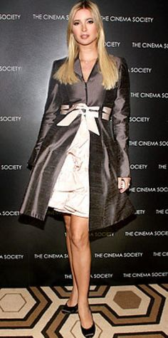 NOVEMBER 30, 2006   Trump put her best foot forward in a gray silk coat, pink ruffle skirt and matching ribbon belt. The model and businesswoman was attending a screening of Gentlemen Prefer Blondes in New York City.