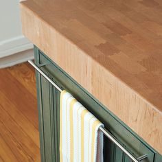 How beautiful is this kitchen island's 4-inch-thick end-grain maple butcher block? Tip: install an oversize bar pull to hang a handy kitchen towel