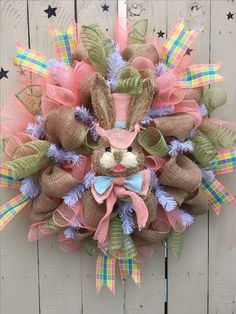 Easter wreath made out of mesh and ribbon. Easter Bunny face. Plaid, coral, green, white!