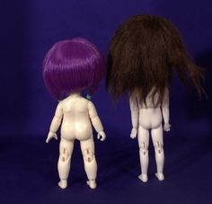 View of their backsides. Lati Yellow on left and Person 21 on right. Both are wearing their stock wigs