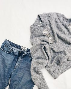 Scandi winter style, acne studios, distressed jeans and fluffy grey jumper with sunnies, effortless scandi style for the cold winter sun