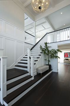 This Spectacular Hamptons inspired Queensland home was the work of Saunders Building. The neutral colours, wall panelling, wainscoting and attention to small details has created a home which is truly magnificent. Hamptons Style Homes, Hamptons House, Hamptons Decor, Staircase Remodel, Staircase Design, Staircase Ideas, House Stairs, House Layouts, House Rooms