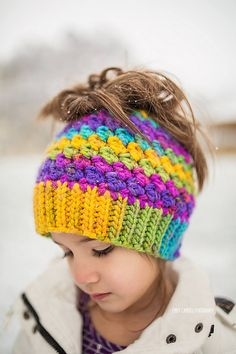 This is a PDF crochet pattern for a beanie with a hole in the top to allow for a ponytail or messy bun. (The pattern also includes instructions to finish this hat off with no opening in the top for a regular beanie.) The pattern is worked from the bottom up with a slip stitch ribbing (you can substitute sc if you like) which creates a fabulous and stretchy knit look. There is a video link tutorial included (for the slip stitch ribbing only). The hole uses an elastic hair tie to stretch over…