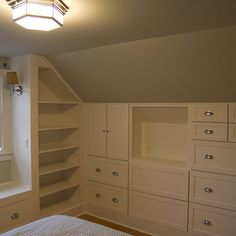 Finished attic built-in drawers and shelves.