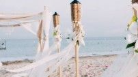 Tiki Torches (unlit) Decorated with Tulle, Sea Shells, and Silk Florals