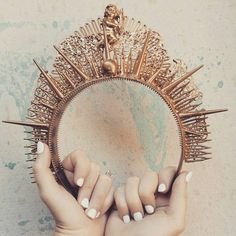 A crown made of spikes and studs is menacing and can give my outfit a look that is meant to be feared.  - judy copley couture   all about the crown @synderelastory