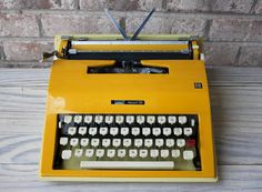 Cursive Script MONTGOMERY WARDS Escort 55 yellow typewriter portable manual 1960s working on Etsy, $400.00