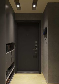 O hall de entrada sóbrio e moderno conta com uma porta de madeira pintada de preto Modern Entrance, House Entrance, Bathroom Interior Design, Modern Interior Design, Foyer Flooring, Southern House Plans, Hallway Designs, Craftsman House Plans, Built In Wardrobe