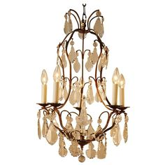 French Crystal and Bronze Chandelier | From a unique collection of antique and modern chandeliers and pendants at https://www.1stdibs.com/furniture/lighting/chandeliers-pendant-lights/