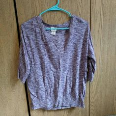"""Purple heathered boat neck sweater Cute comfy boat neck top in heathered purple. Is cute worn off one shoulder or as wide neck. #knit #knittop #boatneck #offtheshoulder #cozy #comfy #stretchy  Brand: mossimo of target Size: medium Measurements: chest20"""" across, waist 19"""" across, length 24""""  {Please ask for any pictures or measurements. Prices negotiable. I love doing cheap bundles on multiple items together! Instagram @jerkelscloset} Mossimo Supply Co. Sweaters Crew & Scoop Necks"""