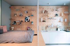 This Studio Apartment has an Amazing Peg Board Storage Wall