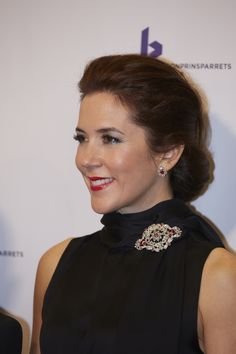 Crown Princess Mary pinned the diamond brooch from the famous ruby parure to the scarf detail on her black dress when she attended this year's Crown Prince Couple's Prizes.