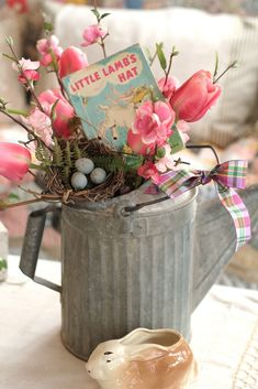 Spring arrangement in old watering can