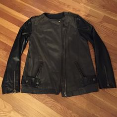 🎉HP🎉Free People faux leather sleeves moto jacket Must have for Fall! Olive green moto jacket with black faux leather sleeves. Worn twice. Perfect condition. Size 10. Asymetrical zip in front. Button snap detail over front pockets. Detail zippers at end of sleeves. One button cover missing- shown in picture. I think it would be easy to match and replace at any fabric store that has a good selection of buttons. Free People Jackets & Coats