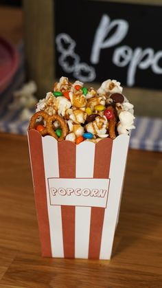 Movie night isn't legit without popcorn, but this adorable DIY popcorn bar takes it to a whole new level.