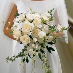 For classic bridal chic, this ivory rose and orchid bouquet will look beautiful on the big day. The large-headed roses and orchids draw the eye and the freesias add beauty as well as their wonderful scent.