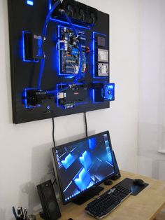 Wall mounted PC http://www.overclock.net/t/1467135/wall-mounted-water-cooled-pc-the-recoilmachine