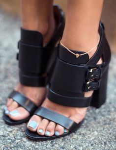 obsessed with these buckled wedge sandals and her teal polish!