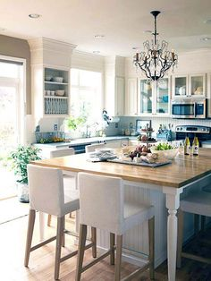 Welcoming White Kitchen…Beaded board backsplash, butcher block island, chandelier!!