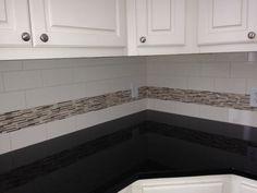 Kitchen Back Splash.  Subway tile (Three Hour Tour) and mosaic (Heavy Rain).