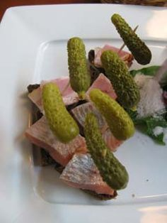 A slice of rye bread with pickled herring, gherkins and ham. A quite typical Latvian beer snack sandwich