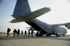 U.S. Marines from Iwakuni Marine Corps Air Station, Japan, arrive at Kunsan Air Base, Republic of Korea, Oct. 24, 2013 as part of exercise Max Thunder 13-2. The purpose of the exercise is to enhance the combat readiness of U.S. and ROK air forces and supporting forces through combined and joint large-force employment training. (U.S. Air Force photo by Staff Sgt. Jessica Haas/Released)