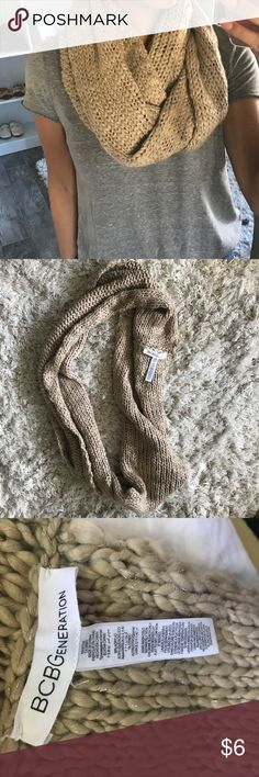 BCBGeneration Infinity Scarf Brown knit scarf from BCBGeneration. No tears or flaws. Has pieces of silver string woven in with the brown.   Size: One Size  🌸Please note that I am not interested in trading at this time🌸 BCBGeneration Accessories Scarves & Wraps