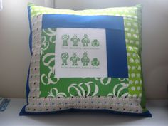A robot pillow for my youngest.  Robot fabric in the center is from Hanies.    This is my second log cabin block i have ever made.. the first was one small coaster. It was so horrible I havent attempted a log cabin since!     Check this out