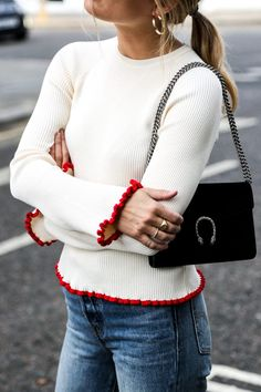 Not too casual jeans&sweater outfit. Purse and earrings are matching perfect.