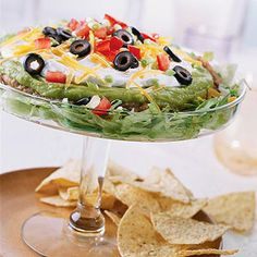 Mexican Seven-Layer Dip This perennial party favorite recipe boasts luscious guacamole, a layer of hearty beans, and cheese.