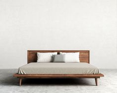 Asher Bed in walnut veneer.