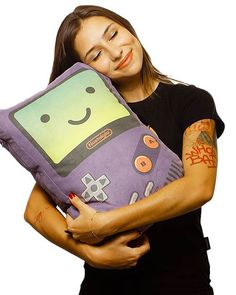 """Nostalgia"", a series of ultra cute retro-gaming cushions in tribute to our beloved NES and Game Boy consoles, designed by Verso. The Game Boy version of is available in 5 colors, paying homage to the cult games like Zelda, Tetris and Kirby, while the NES version offers tributes to Resident Evil and Super Mario Bros"