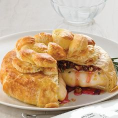 It's easy to impress your guests with this elegant appetizer that features creamy Brie cheese topped with an unexpected combination of sweet and savory ingredients, all wrapped up in flaky puff pastry.
