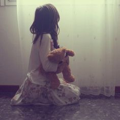 She held her bear close as the sun rose up in her window but she didn't dare open the curtains. She wasn't allowed to look at the outside world