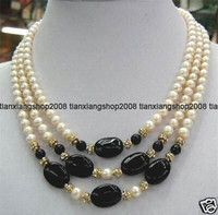 Image from http://www.dhresource.com/albu_843144677_00-1.200x200/beautiful-3-rows-white-pearl-and-black-jade.jpg.
