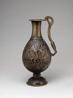 #MetKids Fun Fact: There are two ducks hiding from a wildcat on this container. | Ewer with a Feline-Shaped Handle, 7th century. Islamic. The Metropolitan Museum of Art, New York. Fletcher Fund, 1947 (47.100.90)