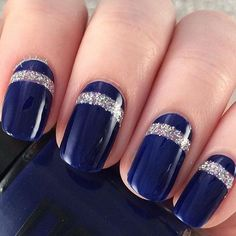 Midnight Blue Nail Art Design with Thick Linings of Silver Glitter for Detail.