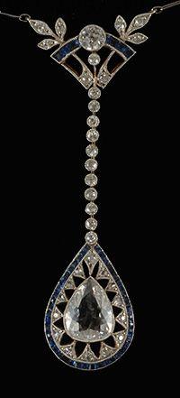 An Art Deco pendant set in platinum, diamonds, calibre sapphire, and a 1.50ct pear-shaped diamond, circa 1920.